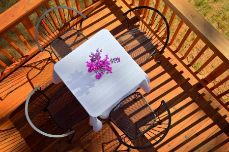 image of an outdoor breakfast table on a sunny morning