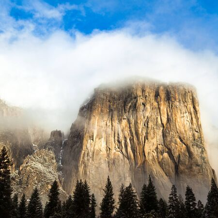 rock formation: El Capitan shrouded by cloudes in Yosemite National Park, California. Stock Photo