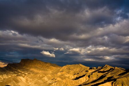 Dramatic clouds at sunrise in Death Valley National Park, California. photo