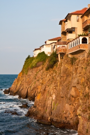 Houses on a steep cliff in Sozopol, Bulgaria. photo