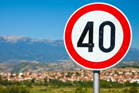 old sign: Old speed limit road sign in rural Bulgaria. Stock Photo
