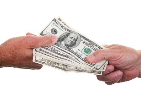 transact: Two people passing a stack of one hundred dollar bills from hand to hand.
