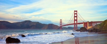 panoramic beach: Golden Gate bridge at sunset seen from Marshall Beach, San Francisco. Stock Photo