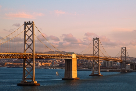 Sunset view of Bay Bridge between Treasure Island and San Francisco, California.