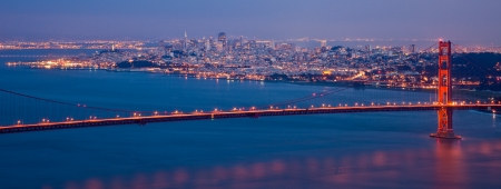 Golden Gate bridge and San Francisco skyline at night seen from Marina Headlands, California. photo