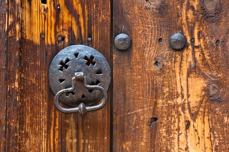 door bolt: Metal knocker on an old wooden door in Plovdiv, Bulgaria.