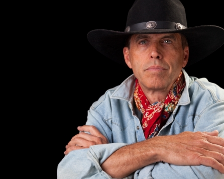 Handsome middle aged man in a cowboy outfit. Stock Photo - 14389805