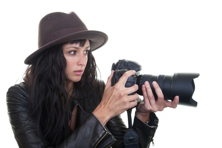 photojournalist: Attractive young woman taking photos with a large DSLR. Stock Photo