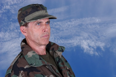 Middle aged army veteran looking up into the distance. Stock Photo - 14389808