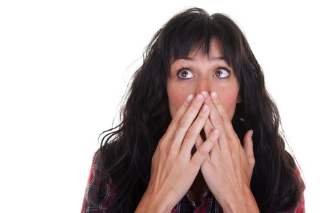 fear woman: Pretty young woman covering her mouth in surprise.