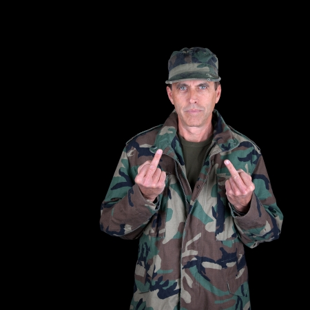Stern army veteran showing you two middle fingers.
