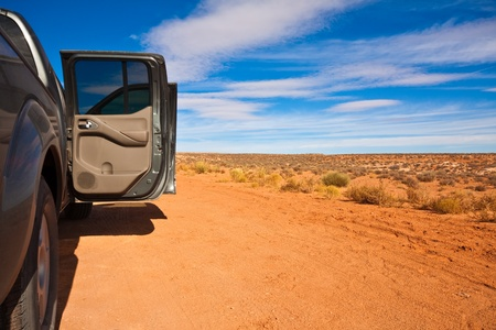 open car door: Car pulled over on the side of a desert road in Arizona  Stock Photo