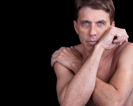 Nice portrait of a handsome shirtless man in a pensive pose. Stock Photo - 14452228
