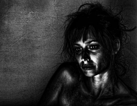 Artistic portrait of a sad woman in dramatic lighting. photo