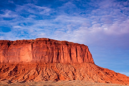 Sunlit rocks and dramatic sky in Monument Valley, Utah. photo
