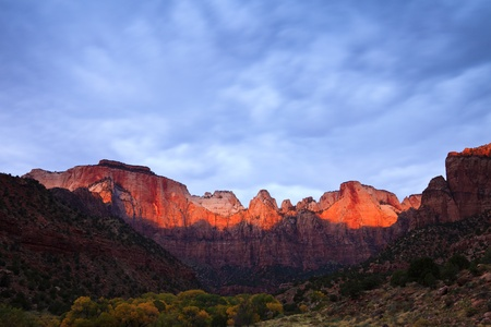 Sun rays hitting the top of Towers of the Virgin in Zion Canyon National Park, Utah. photo