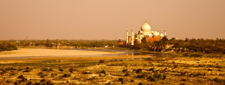 Sunset view of Taj Mahal and Yamuna river from Agra Fort. photo