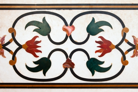 monument in india: Floral design of precious stones on marble on the walls of Taj Mahal monument, India.