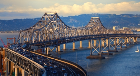 trafic: Bay Bridge in late afternoon light seen from Treasure Island.