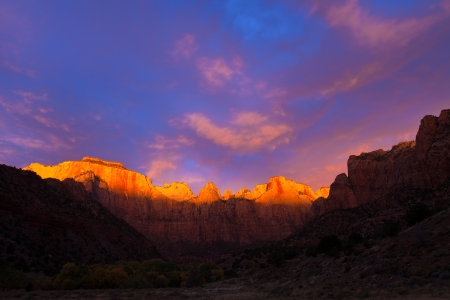spire: The sun kisses the top of the Towers of the Virgin at Zion Canyon National Park, Utah.