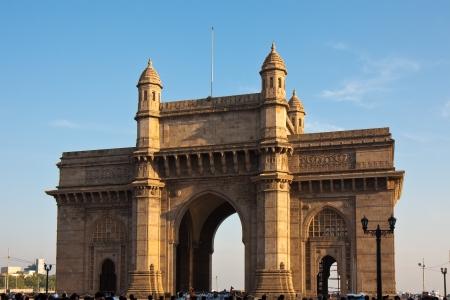 日没、ムンバイ、インドでインドへのゲートウェイです。 写真素材