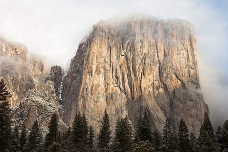 rock formations: El Capitan shrouded by cloudes in Yosemite National Park, California. Stock Photo