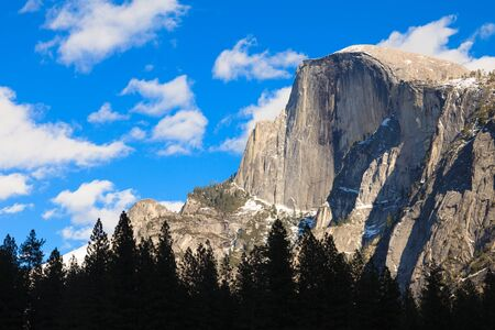 sierra snow: Late afternoon view of Half Dome peak in Yosemite National Park, California