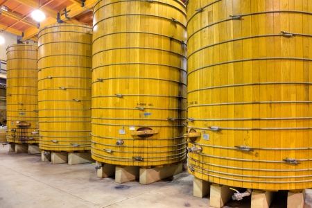 Large wooden casks in a California winery cellar.