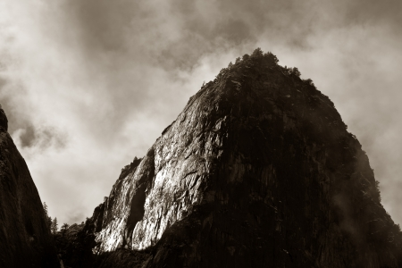 Dramatic view of a mountain peak in the fog in Yosemite National Park, California. Stock Photo - 14807041