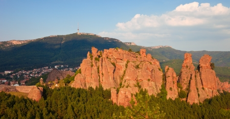 View of the famous Belogradchik rocks, castle, and town in Bulgaria. photo