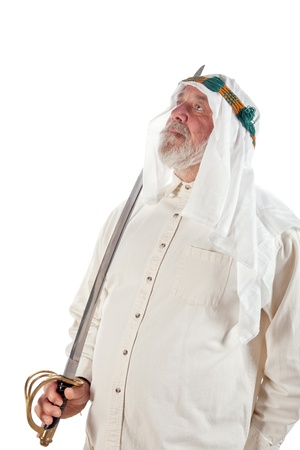 middle eastern clothes: Older arab man holding a sword isolated on white  Stock Photo