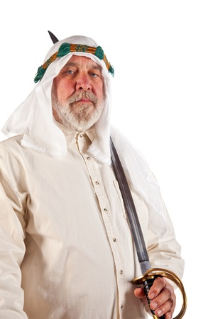 Older Arab man holding an antique sword  Stock Photo - 15044597