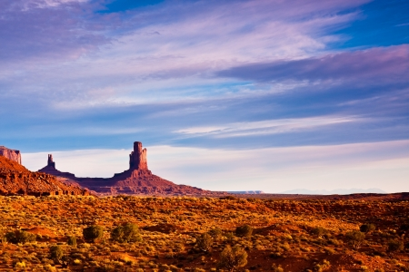 pinnacle: Rock buttes at sunrise in Monument Valley Tribal Park, Arizona  Stock Photo