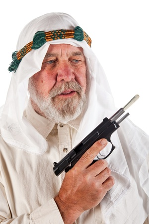 Arab man holding a gun stuffed with a hunderd dollar US bill. photo