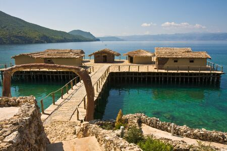 fishing huts: Ancient village reconstruction on lake Ohrid in Macedonia.