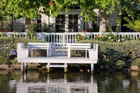 glass fence: House on a canal in Venice Beach, California. Stock Photo