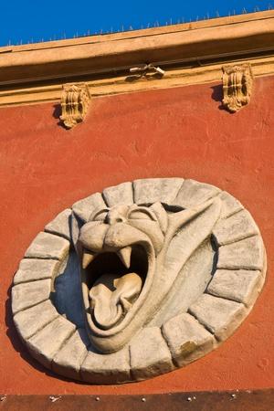 Stone demon head statue on a building in Venice Beach, California. photo
