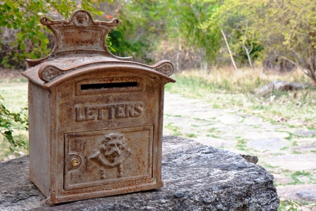 residential tree service: Ornate rusty mailbox in, India. Stock Photo