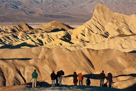 manly man: Tourists taking photos at sunrise in Death Valley National Park, California