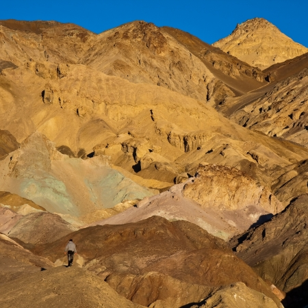 foothill: Lone Hiker at Artist Palette in Death Valley National Park, California