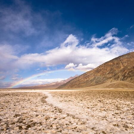 Rainbow over Death Valley photo