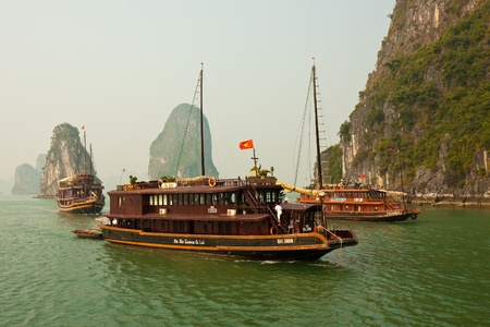 HALONG BAY, VIETNAM - NOVEMBER 30: Tourist junks navigating through the karst islands in Halong Bay. This is one of Vietnams prime travel destinations and a UNESCO World Heritage Site. Taken on November 30, 2009.