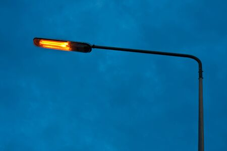 street lamp: Lit lamp against a dramatic sky in Phuket, Thailand. Stock Photo