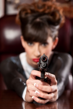 handguns: Girl in a painted pinstripe suit pointing a gun at the viewier.