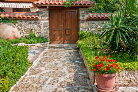 door leaf: Yard and entrance of an old house in Sozopol, Bulgaria.