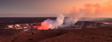 Fire glow coming out of the active Halemaumau crater in Volcanoes National Park, Hawaii Big Island. photo