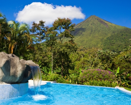 rica: Pool with a view of the green side of Arenal Volcano, Costa Rica.