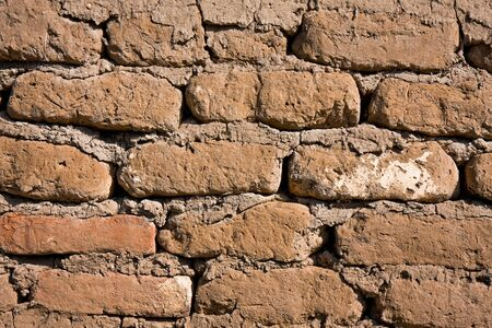 mud wall: Abstract background of a 100 year old mud brick wall. Stock Photo