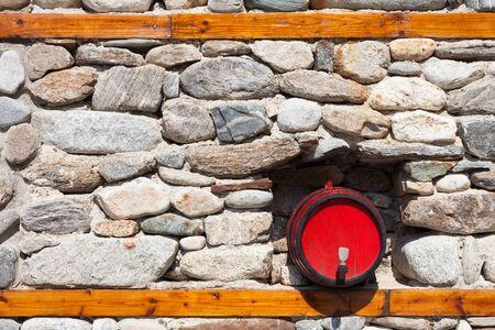 Decorative wine barrel in a stone wall in Bulgaria.