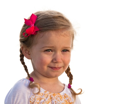Cute little girl smiling shily, isolated on white background. Stock Photo - 16606891